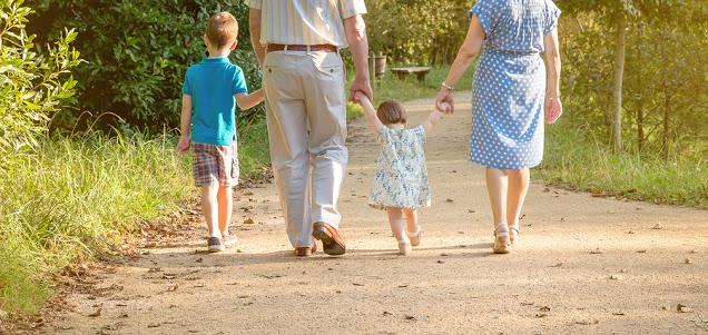 grandparents walking with grandkids